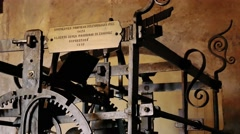 Ancient gear and clockwork in the clock tower of Mantua Stock Footage