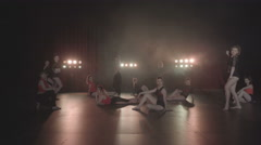 Dance performance of female group on a stage with lights and smoke - stock footage