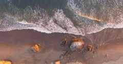 Aerial of ocean waves crashing on beach in California, San Francisco Stock Footage