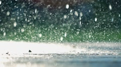 Scattering raindrops, shallow DOF. Super slow motion video, 500 fps Stock Footage
