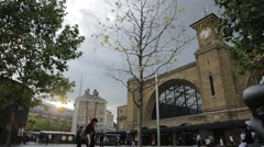 Wide Shot of Kings Cross Station with Sun and Clouds Stock Footage