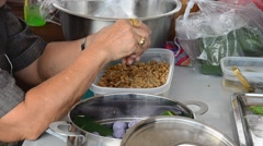 People cooking Chor Muang is royal Thai cuisine which required for refinement Stock Footage