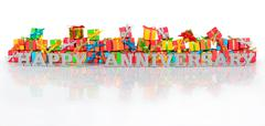Happy anniversary silver text and varicolored gifts - stock photo