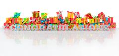 Congratulations silver text and varicolored gifts Stock Photos