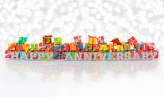 Happy anniversary silver text and varicolored gifts Stock Photos