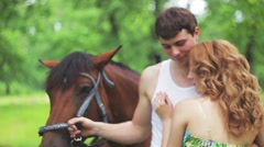 Lovers ride horses in the park, Slow Motion Stock Footage