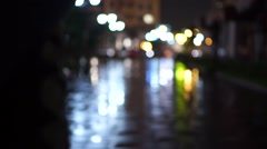 Girl with umbrella walking at rainy night, bokeh video Stock Footage