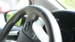 Detail of hands turning steering wheel Stock Footage