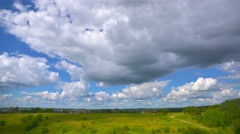 Landscape, stormy cumulus clouds rolling over countryside time-lapse. Stock Footage