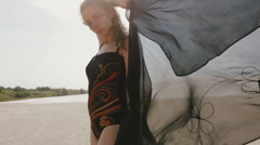 Young woman fashion posing in swimsuit and cloth at desert - stock footage