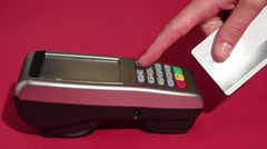 Hand dialing pin code on pin pad of pos terminal and swipe credit card Stock Footage