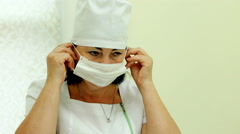 Mid shot Doctor dresses white special mask Stock Footage