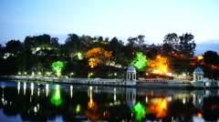 Colored lights near lake and ancient gazebos. Stock Footage