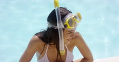 Smiling woman in swim suit wears goggles Stock Footage
