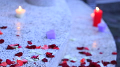 Rose petals and candle Stock Footage