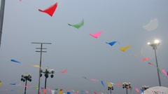 Movement of colorful flags and Stormy Clouds Stock Footage