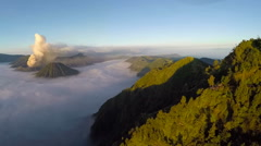 Aerial view flight over Mount Bromo volcano during sunrise. Stock Footage