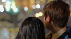 Couple in love enjoying view on beautiful night city, romance, togetherness Arkistovideo