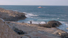 Tourists watching the rough ocean waves in Malta Stock Footage
