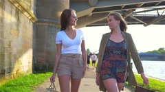 Two girl walking after shopping and talking. Stock Footage