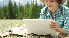 Beautiful brown girl, in a wasteland, using a tablet pc Stock Footage