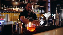 Bartender with piercings and dreadlocks working Stock Footage