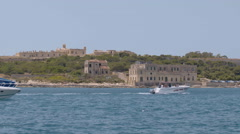 Yachts passing by near Manoel Island Malta Stock Footage