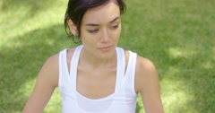 Calm young woman in white blouse with grin Stock Footage