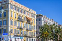 Sunny houses on the street in Nice, France Stock Photos