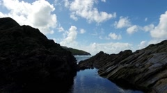 Gentle upward pan over coastal devonian rock rockpools. Stock Footage