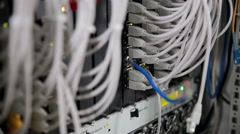 Back side of working data servers with many wires, cables Stock Footage