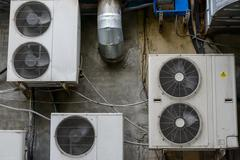 Group of air conditioner units outside building Stock Photos