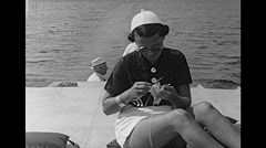 USA 1945: woman knitting during a cruise Stock Footage