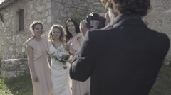 Bride and Bridesmaids having photos taken - stock footage