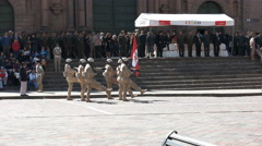 Soldiers marching in front of the cathedral of cusco Stock Footage