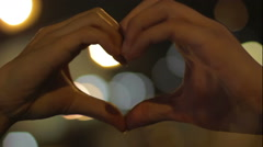 Female and male hands showing heart hand sigh, love and tenderness, relationship Stock Footage