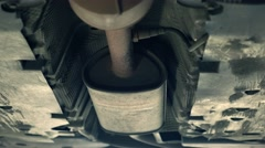 Bottom of the car and exhaust pipe 4K zoom in shot. Car maintenance at service Stock Footage