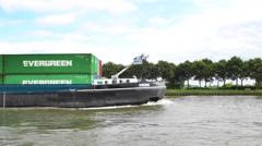 Barge with shipping containers passing Stock Footage