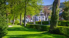 Munster green village in Vosges mountains Stock Photos