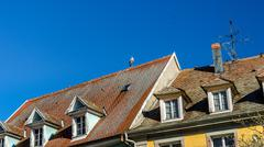 Stork on the roof of a house in Munster, Alsace Stock Photos