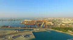 Aerial Dubai ship yard Persian gulf video 4k. Port Waterfront harbor Cargo UAE Stock Footage