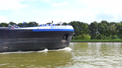 Oil shipping barge passing on a canal Stock Footage