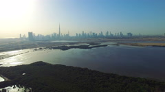 Aerial Dubai cityscape Ras Al Khor video 4k. Skyscrapers United Arab Emirates Stock Footage