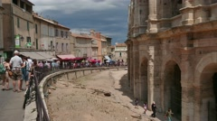 Tourists Visiting The French City Of Arles With Amphitheatre Arena - stock footage