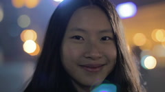 Happy Asian girl pulling faces for camera, smiling and having fun, good actress Stock Footage