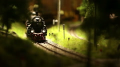 A model of a train moves down the miniature railroad Stock Footage