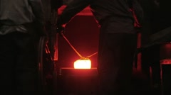Men at work, forging steel machine inside industrial plant Stock Footage