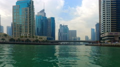 Sailing Boat Dubai Jumeira Marina video 4k. Skyscrapers building Real Estate UAE Stock Footage