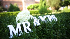 Sign for wedding Mr Mrs mister and missis with flowers in the grass - stock footage
