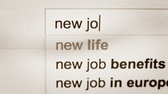 Words new job being typed in the search line of the Internet browser Stock Footage